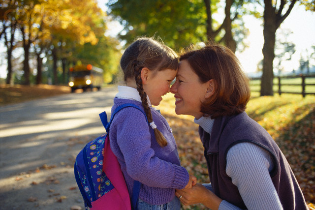 Mother and Daughter Waiting for School Bus